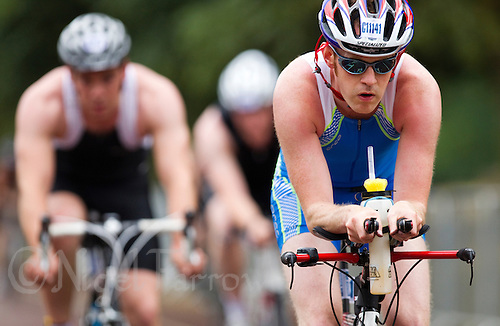 25 JUL 2010 - LONDON, GBR - Competitors make their way round the bike course during the Age Group races at the  London round of the ITU World Championship Series triathlon .(PHOTO (C) NIGEL FARROW)