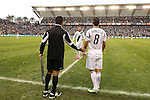 01 December 2012: Los Angeles' David Beckham (ENG) (23) subs out of the game as Marcelo Sarvas (BRA) (8) and fourth official Hilario Grajeda (left) wait. The Los Angeles Galaxy played the Houston Dynamo at the Home Depot Center in Carson, California in MLS Cup 2012. Los Angeles won the game 3-1.