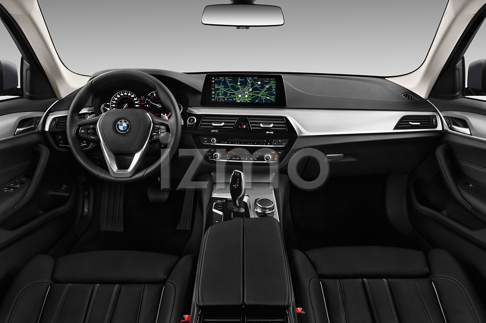 Stock photo of straight dashboard view of 2018 BMW 5 Series Touring Sport 5 Door Wagon