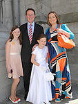 Aoibheann Ní Fhearaigh from Scoil Aonghusa who recieved first holy communion at St Peters church West street pictured with parents Martin and Rachel and sister Rachel. Photo: Colin Bell/pressphotos.ie