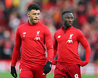 27th October 2019; Anfield, Liverpool, Merseyside, England; English Premier League Football, Liverpool versus Tottenham Hotspur; substitute Alex Oxlade-Chamberlain of Liverpool with team mate Naby Keita of Liverpool during the pre-match warm up - Strictly Editorial Use Only. No use with unauthorized audio, video, data, fixture lists, club/league logos or 'live' services. Online in-match use limited to 120 images, no video emulation. No use in betting, games or single club/league/player publications
