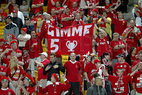 25 May 2005: Liverpool fans hold up banners in the stands before the UEFA Champions League Final between AC Milan and Liverpool played at the Ataturk Olympic Stadium, Istanbul, Turkey. Liverpool beat AC Milan 3-2 on penalties after the game finished 3-3 after extra time, and lifted the European Cup for the fifth time. Photo: Neil Tingle/actionplus..050521 football soccer fan supporter crowd