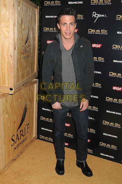 """Colton Haynes.""""Deus Ex: Human Revolution"""" Launch Party held at The Roxbury, Hollywood, California, USA..August 23rd, 2011.full length jacket top jeans denim grey gray  .CAP/ADM/BP.©Byron Purvis/AdMedia/Capital Pictures."""