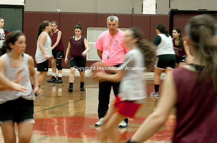 TORRINGTON, CT--- -120215JS04--Torrington head coach Mike Fritch looks on during pre-season conditions and practice for his team Wednesday at the high school. <br /> Jim Shannon Republican-American