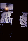 PhOto of engine with headlamp &quot;on&quot; coming down track. Taken from back of aR.R. car.<br /> D&amp;RGW