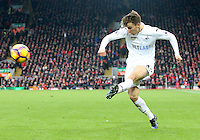 Tom Carroll of Swansea City crosses the ball into the box for Fernando Llorente of Swansea City to score Swanseas second goal of the Premier League match between Liverpool and Swansea City at Anfield, Liverpool, Merseyside, England, UK. Saturday 21 January 2017