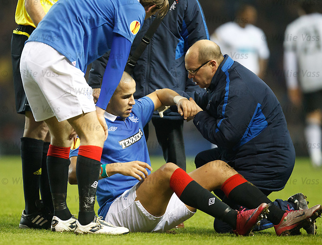 Madjid Bougherra gets treatment for a shoulder injury
