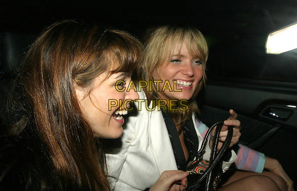 KELLY BROOK & DANIELLE BRENT.Brits after party at Kensington Roof Gardens.17 February 2004.laughing.www.capitalpictures.com.sales@capitalpictures.com.© Capital Pictures.