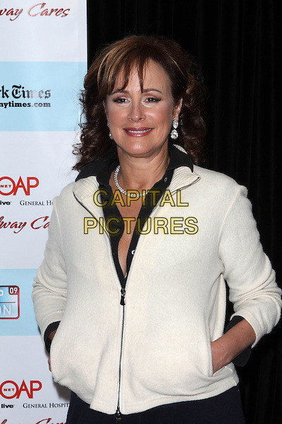 HILARY B. SMITH.5th Annual ABC & SOAPnet salute Broadway Cares/Equity Fights AIDS Benefit held at Marriott Marquis New York City, New York, NY, USA..March 9th, 2009.half length black trim white ream jacket hands in pockets .CAP/ADM/PZ.©Paul Zimmerman/AdMedia/Capital Pictures.
