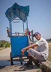 Havana, Cuba:<br /> Street vendor and cart