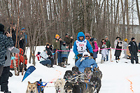 Tim Pappas and team run past spectators on the bike/ski trail near University Lake with an Iditarider in the basket and a handler during the Anchorage, Alaska ceremonial start on Saturday, March 7 during the 2020 Iditarod race. Photo © 2020 by Ed Bennett/Bennett Images LLC