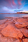 A colorful sunrise above Warm Creek Bay starts the day at Lake Powell in the Glen Canyon National Recreation Area in Arizona/Utah, USA