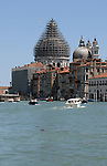 View along Grand Canal, showing scaffholding and ship passing on other side of lagoon, Venice, Italy. May 2007.