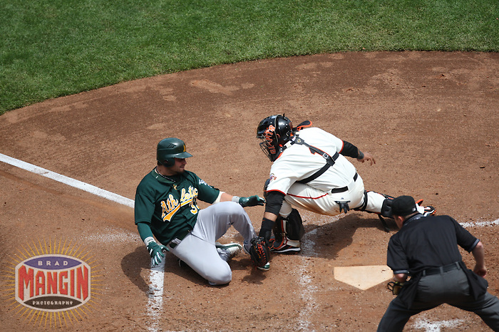 SAN FRANCISCO, CA - June 10:  Nick Swisher of the Oakland Athletics slides into home plate as San Francisco Giants catcher Bengie Molina applies the tag during the game at AT&T Park in San Francisco, California on June 10, 2007.  Photo by Brad Mangin