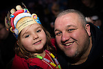 © Joel Goodman - 07973 332324 . 17 November 2013 . Oldham , UK . Daughter Grace Esbach (four) and dad Mark Esbach (both correct, from Oldham) watch the show . The Christmas lights are turned on in Oldham Town Centre . Photo credit : Joel Goodman