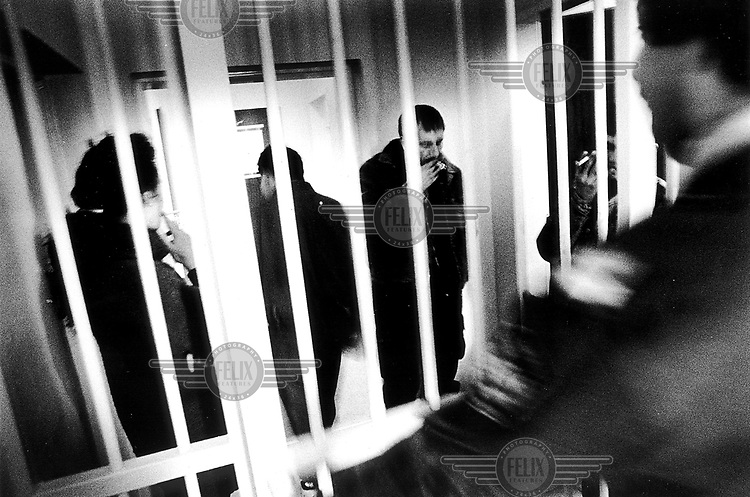 ©Piet den Blanken/Panos Pictures..Austria, Neusiedl, 1998. Arrested Rumanians in a Austrian police prison on the border with Hungary. .Ten years ago on this spot the first holes fell in the Iron Curtain. Nowadays it is the most heavily guarded and hardest to pass border of the European Union.