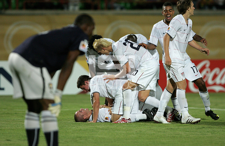 The United States' Brian Ownby (15) celebrates with teammates after the forth goal against  Cameroon during the FIFA Under 20 World Cup Group C Match between the United States and Cameroon at the Mubarak Stadium on September 29, 2009 in Suez, Egypt.