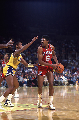 "1986-87:  Julius Erving, ""Dr. J"", #6 of the Philadelphia 76ers in action during a Sixers game versus the Los Angeles Lakers at the Great Western Forum in Inglewood, CA.."