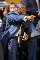 18 November 2010:  FIU Basketball Head Coach Isiah Thomas signals to his players in the first half as the Florida State University Seminoles defeated the FIU Golden Panthers, 89-66, at the U.S. Century Bank Arena in Miami, Florida.