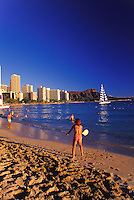 Diamond head with Waikiki beach, ocean, hotels and tourists playing in the foreground