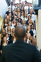 High school students perform in a string orchestra and choir before the start of the Westerville School Board meeting at Central High School. The board meeting was to discuss, in addition to normal business, how to make  financial cuts after a tax levy that would have raised $23 million failed forcing the board to close some programs. Music, sports and some busing are among the proposed cuts.