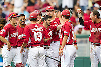 Arkansas Razorbacks outfielder Andrew Benintendi (16) is celebrates with his teammates after slugging a home run against the Virginia Cavaliers in Game 1 of the NCAA College World Series on June 13, 2015 at TD Ameritrade Park in Omaha, Nebraska. Virginia defeated Arkansas 5-3. (Andrew Woolley/Four Seam Images)