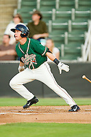 Greensboro Grasshoppers second baseman Blake Barber (8) follows through on a solo home run against the Kannapolis Intimidators at CMC-Northeast Stadium on July 12, 2013 in Kannapolis, North Carolina.  The Grasshoppers defeated the Intimidators 2-1.   (Brian Westerholt/Four Seam Images)