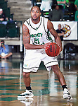 North Texas Mean Green guard Shannon Shorter (21) looks for a open player  in the game between the Jackson State Tigers and the University of North Texas Mean Green at the North Texas Coliseum,the Super Pit, in Denton, Texas. UNT defeated Jackson 68 to 49