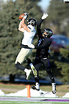 SIOUX FALLS, SD, NOVEMBER 26:  Andrew Dather #18 from Harding University hauls in a pass in front of Clifford Redmond #2 from the University of Sioux Falls Saturday afternoon at Bob Young Field in Sioux Falls. (Photo by Dave Eggen/Inertia)