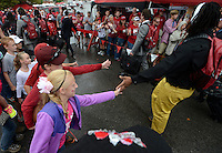STAFF PHOTO ANTHONY REYES &bull; @NWATONYR<br /> Hadley Casey, 10, of Bentonville, slaps hands with passing players Saturday, Sept. 6, 2014 before the University of Arkansas' football game against Nicholls State in lot 56 in Fayetteville. This is the first home game of the season and the Razorbacks hope to break a 10 game losing streak.