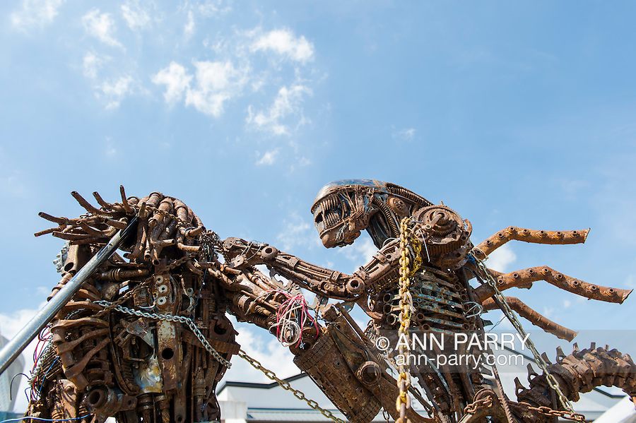 Garden City, New York, USA. June 14, 2015. TThe Alien sculpture, by artist Hale Storm of Freeport, was assembled and on display outdoors at Eternal Con, the Long Island Comic Con, at the Cradle of Aviation museum. The sculptor created the metal artwork from automotive and motorcycle parts.