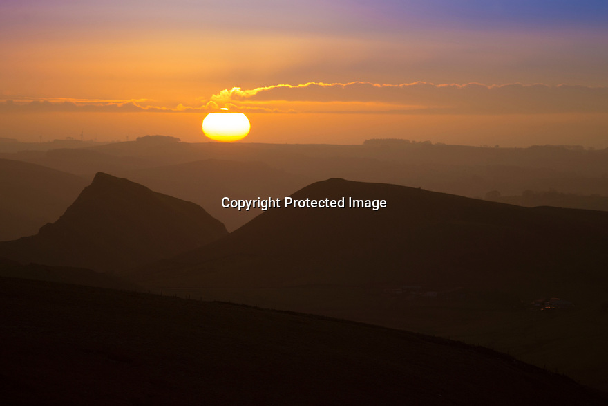 08/01/16<br /> <br /> After weeks of higher than average temperatures, an icy dawn breaks over Chrome Hill as seen from Axe Edge in the Derbyshire Peak District near Buxton.<br /> <br /> All Rights Reserved: F Stop Press Ltd. +44(0)1335 418365   +44 (0)7765 242650 www.fstoppress.com