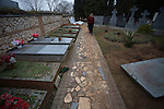 Each headstone, placed by families, marks the site of a mass grave without to exhume, near which is being open.
