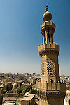 Cairo, Egypt -- View from the minarets of the Bab Zuwayla gate.  One of the three first gates installed around the historic walled city of Cairo, standing at the southern boundary of old Fatimid Cairo.  The two minarets atop this tower actually belong to the nearby Mosque of al-Mu'ayyad, which sits just inside this gate (on the left).  For a small fee, it is possible to climb the minarets for a spectacular view of old and new Cairo, featuring many minarets above the old city. © Rick Collier / RickCollier.com