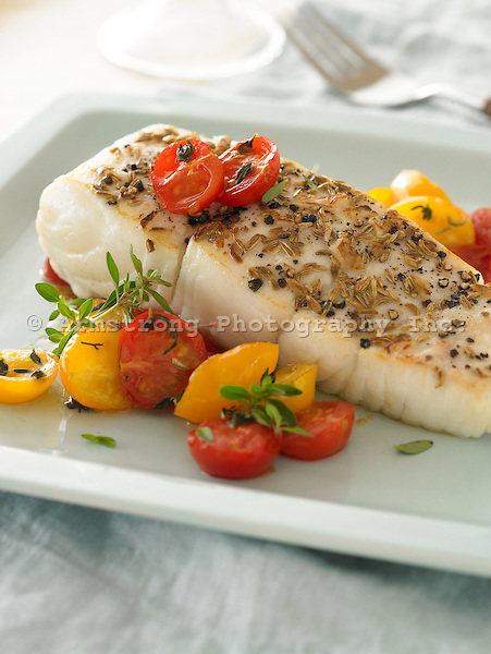 Halibut coated in anise seeds and cracked black pepper, with cherry tomatoes and herbs