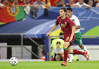 Postiga Helder (23) of Portugal runs onto a loose ball ahead of Carlos Salcido (3) of Mexico. Portugal defeated Mexico 2-1 in their FIFA World Cup Group D match at FIFA World Cup Stadium, Gelsenkirchen, Germany, June 21, 2006.