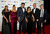 LL COOL J, center, arrives with his Mother, Andrea Smith, left and his wife, Simone Smith, right, and family for the formal Artist's Dinner honoring the recipients of the 40th Annual Kennedy Center Honors hosted by United States Secretary of State Rex Tillerson at the US Department of State in Washington, D.C. on Saturday, December 2, 2017. The 2017 honorees are: American dancer and choreographer Carmen de Lavallade; Cuban American singer-songwriter and actress Gloria Estefan; American hip hop artist and entertainment icon LL COOL J; American television writer and producer Norman Lear; and American musician and record producer Lionel Richie. Photo Credit: Ron Sachs/CNP/AdMedia