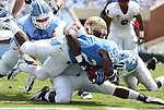 01 September 2012: UNC's Giovanni Bernard (26) fights through a tackle by Elon's Chris Jones (98) to score his second touchdown. The University of North Carolina Tar Heels played the Elon University Phoenix at Kenan Memorial Stadium in Chapel Hill, North Carolina in a 2012 NCAA Division I Football game.