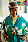 Bolivian cholita is dressed in bowler hat and manta or shawl, the traditional indigenous Aymaran dress and hat, celebrating Independence Day in La Paz, Bolivia.
