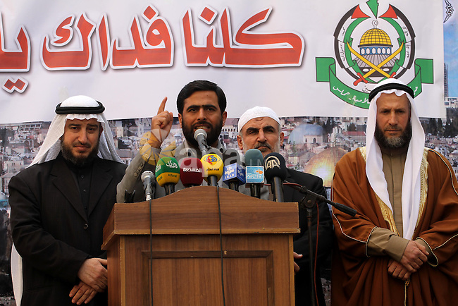 "Mushir Al Masri, a Hamas MP and media spokesman, gives a speech during a demonstration organised by Islamist movement Hamas against the cover cartoon of the Prophet published by French satirical magazine Charlie Hebdo in Jabalia refugee camp in the northern Gaza Strip on January 23, 2015. Charlie Hebdo has printed cartoons depicting Mohammed, including one on the cover of its ""survivors"" issue published after jihadist gunmen attacked its Paris offices, killing 12 people. Photo by Mohammed Asad"