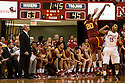 December 3, 2012: Kevin O'Neill head coach of the USC Trojans watching his player J.T. Terrell (20) shoot from the three point line against Ray Gallegos (15) of the Nebraska Cornhuskers at the Devaney Sports Center in Lincoln, Nebraska. Nebraska defeated USC 63 to 51.