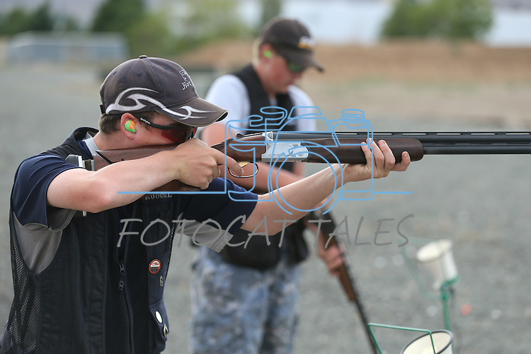 Robert Lamkin, 13, practices at the Capital City Gun Club, in Carson City, Nev., on Friday, July 11, 2014.<br /> Photo by Cathleen Allison