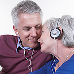 USA, California, Fairfax, Mature couple listening music together
