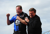 Feb. 19, 2012; Chandler, AZ, USA; NHRA pro stock driver Allen Johnson (left) with Larry Morgan during the Arizona Nationals at Firebird International Raceway. Mandatory Credit: Mark J. Rebilas-