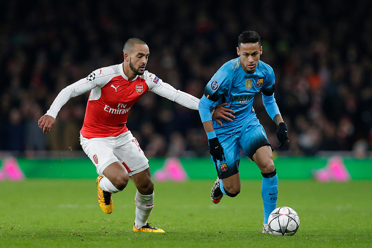 Barcelona's Neymar holds off the challenge from Arsenal's Theo Walcott<br /> <br /> Photographer Craig Mercer/CameraSport<br /> <br /> Football - UEFA Champions League Round of 16 - Arsenal v Barcelona - Tuesday 23rd February 2016 - Emirates Stadium - London<br /> <br /> &copy; CameraSport - 43 Linden Ave. Countesthorpe. Leicester. England. LE8 5PG - Tel: +44 (0) 116 277 4147 - admin@camerasport.com - www.camerasport.com