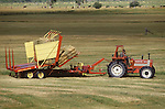 1984 Heston 780 DT tractor in hay field pulling a New Holland hay stacker along the Green River, Wyoming