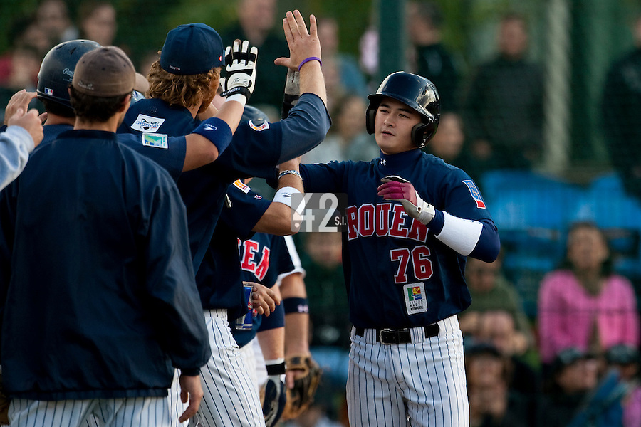 10 october 2009: Kenji Hagiwara is congratulated by his teammates as he hits a home run during game 3 of the 2009 French Elite Finals won 4-2 by Savigny over Rouen, at Stade Jean Moulin stadium in Savigny sur Orge, near Paris, France.