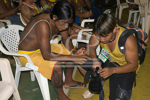 "Altamira, Brazil. ""Xingu Vivo Para Sempre"" protest meeting about the proposed Belo Monte hydroeletric dam and other dams on the Xingu river and its tributaries. Irekoko Kayapo learning from Marika Kuikuro about video making."