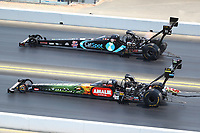 Jul 29, 2018; Sonoma, CA, USA; NHRA top fuel driver Terry McMillen (near) races alongside Scott Palmer during the Sonoma Nationals at Sonoma Raceway. Mandatory Credit: Mark J. Rebilas-USA TODAY Sports