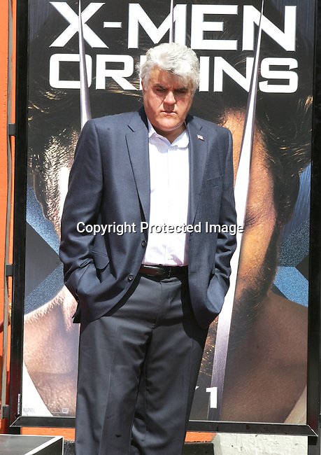 HOLLYWOOD, CA. - April 21: Jay Leno attends the Handprint And Footprint Ceremony Honoring Hugh Jackman at Grauman's Chinese Theatre on April 21, 2009 in Hollywood, California.